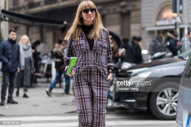 Lisa Aiken wearing a checked overall outside Emilio Pucci during Milan Fashion Week Fall/Winter 2017/18 on February 23 2017 in Milan Italy