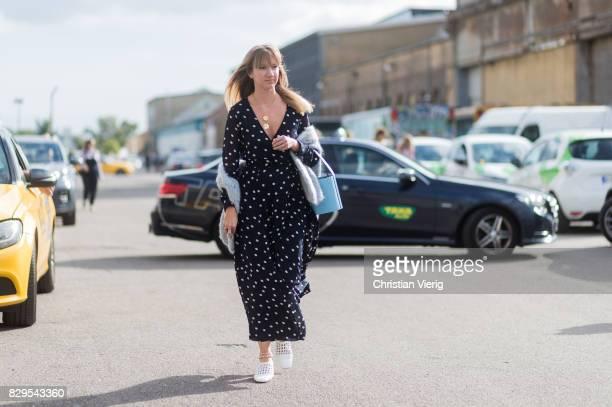Lisa Aiken wearing a dress with dot print outside Ganni on August 10 2017 in Copenhagen Denmark