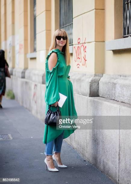 Lisa Aiken wearing a green dress is seen outside Bottega Veneta during Milan Fashion Week Spring/Summer 2018 on September 23 2017 in Milan Italy