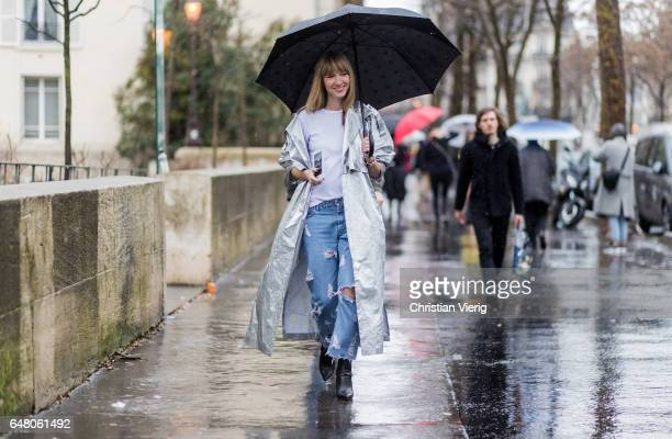 Lisa Aiken wearing a silver coat and ripped denim jeans outside Mugler on March 4 2017 in Paris France