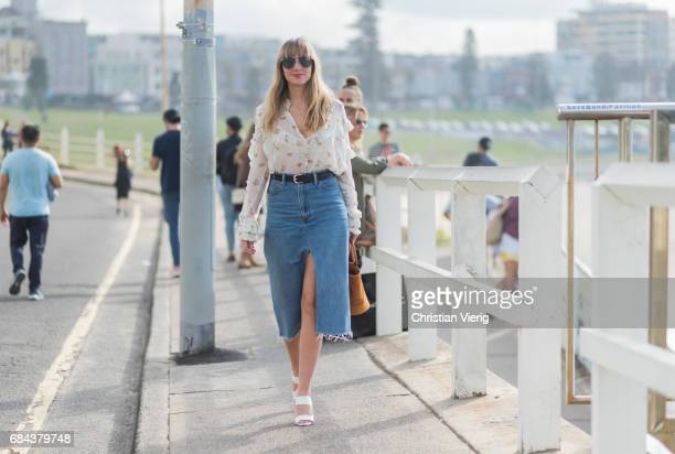 Lisa Aiken wearing a white blouse denim skirt sandals outside Ten Pieces at day 5 during MercedesBenz Fashion Week Resort 18 Collections at Icebergs...