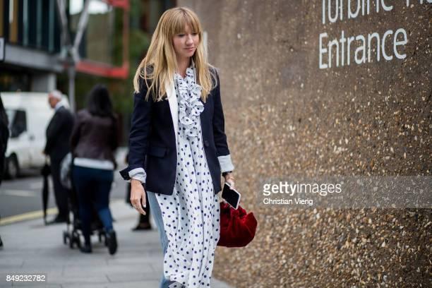 Lisa Aiken wearing a white dress outside Christopher Kane during London Fashion Week September 2017 on September 18 2017 in London England