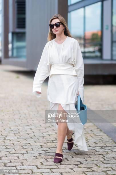 Lisa Aiken wearing a white dress outside Designers Remix on August 10 2017 in Copenhagen Denmark