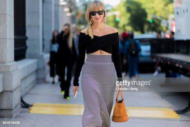 Lisa Aiken wearing cropped top midi skirt seen in the streets of Manhattan outside Tory Burch during New York Fashion Week on September 8 2017 in New...