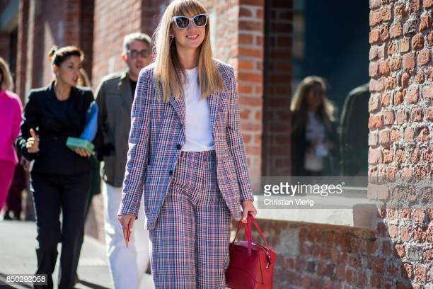 Lisa Aiken wearing grey checked suit is seen outside Gucci during Milan Fashion Week Spring/Summer 2018 on September 20 2017 in Milan Italy