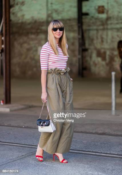 Lisa Aiken wearing high waisted pants JW Anderson bag striped top at day 4 during MercedesBenz Fashion Week Resort 18 Collections at Carriageworks on...