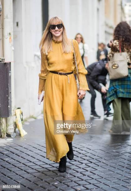 Lisa Aiken wearing yellow dress is seen outside Chloe during Paris Fashion Week Spring/Summer 2018 on September 28 2017 in Paris France