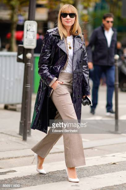 Lisa Aiken wears a black coat flare pants outside Giambattista Valli during Paris Fashion Week Womenswear Spring/Summer 2018 on October 2 2017 in...