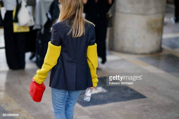 Lisa Aiken wears a blazer jacket with yellow wool sleeves outside the Lemaire show during Paris Fashion Week Womenswear Spring/Summer 2018 on...