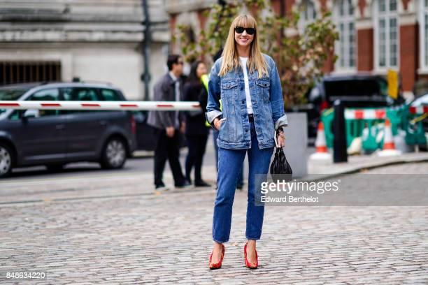 Lisa Aiken wears a blue denim jacket outside Preen by Thornton Bregazzi during London Fashion Week September 2017 on September 17 2017 in London...