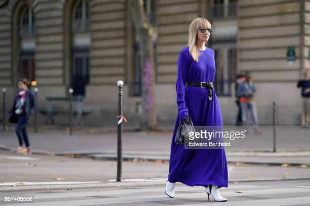 Lisa Aiken wears a blue dress outside Thom Browne during Paris Fashion Week Womenswear Spring/Summer 2018 on October 3 2017 in Paris France