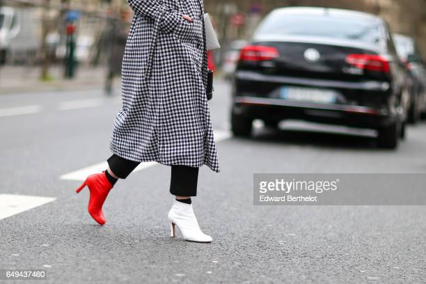 Lisa Aiken wears a checked trench coat a red shoes and a white shoe outside the Ellery show during Paris Fashion Week Womenswear Fall/Winter...