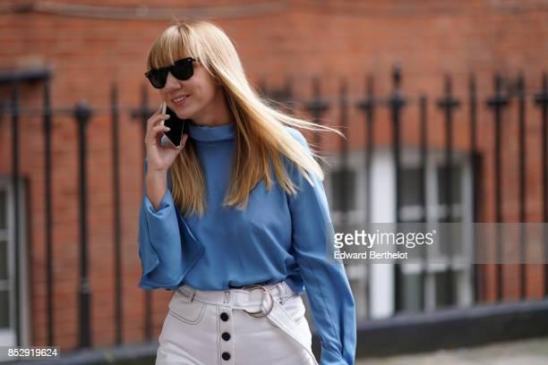 Lisa Aiken wears sunglasses a blue ruffled top white pants outside JW Anderson during London Fashion Week September 2017 on September 16 2017 in...