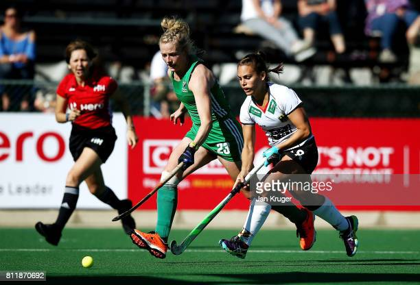 Lisa Altenburg of Germany battles with Hannah Matthews of Ireland during day 2 of the FIH Hockey World League Women's Semi Final Pool A match between...