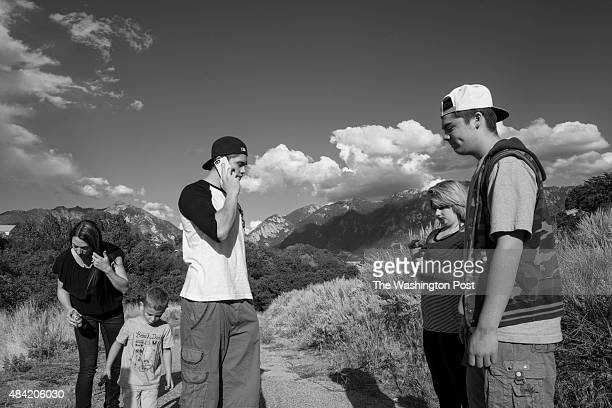 Lisa Angelos is shown with her son Nico as Anthony Angelos Meranda Angelos and Jesse chat with her brother Weldon during a call from prison while...