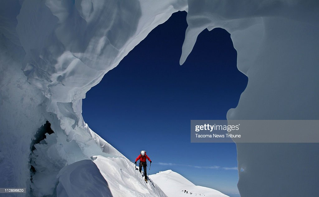 Lisa Beaudreau, of Seattle, is framed by a bergschrund as she descends Mt. Rainier, July 9, 2010. A bergschrund is a crevasse at the top of a glacier.