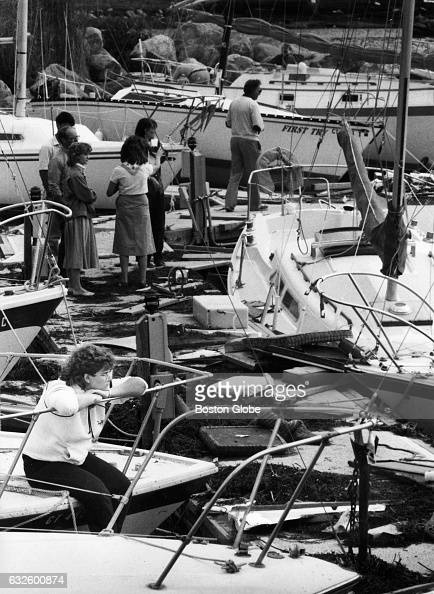 Lisa Bernat of Wilamantic Conn oversees the damage left from Hurricane Gloria from the bow of her parents' boat in the village of Noank in Groton...