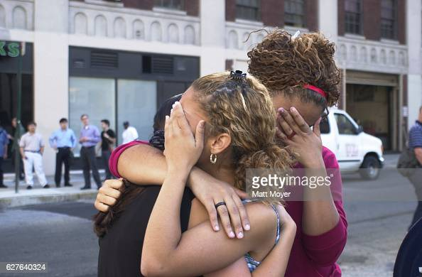 Lisa Bianco and two women comfort one another during the terrorist attack on The World Trade Center on Sept 11 2001