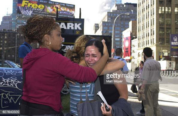 Lisa Bianco comforts two women during the terrorist attack on The World Trade Center on Sept 11 2001