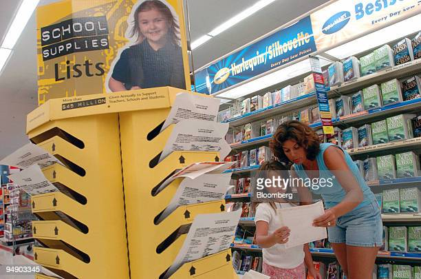 Lisa Bicer right and her daughter Rachael check their to do list as they shop for back to school items at a WalMart in East Reading Pennsylvania on...