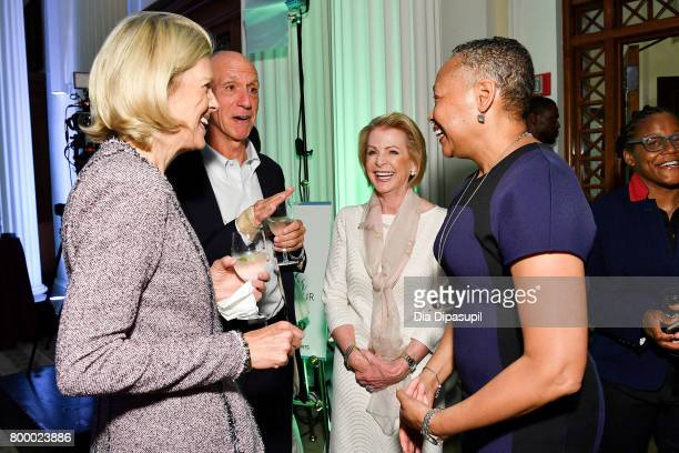 Lisa Borders and Deborah Antoine speak with guests during the Women's Sports Foundation 45th Anniversary of Title IX celebration at the NewYork...