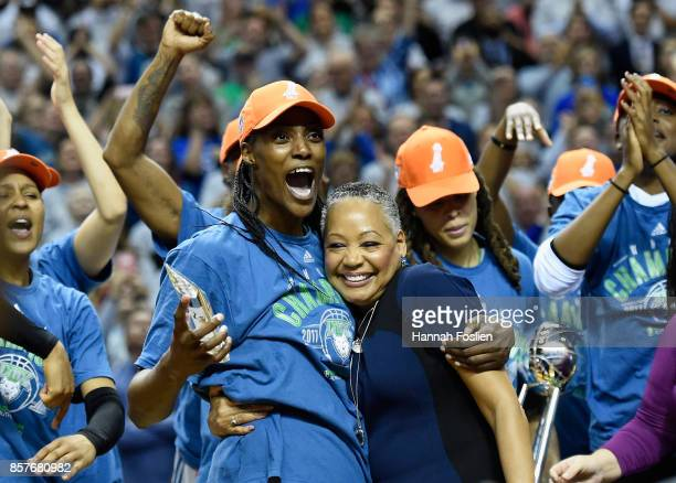 Lisa Borders President of the WNBA presents Sylvia Fowles of the Minnesota Lynx the MVP of the WNBA Finals after a defeat of against the Los Angeles...