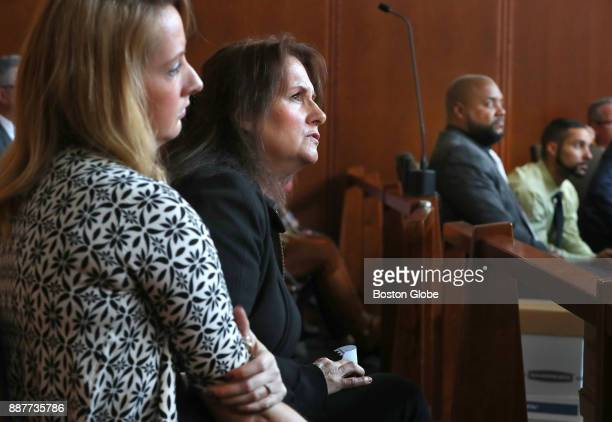 Lisa Brown center the mother of Joshua Messier and his sister Danielle Messier left look at an image projected on a screen in the courtroom as two of...