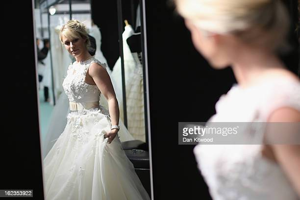 Lisa Chapple tries on a wedding dress during the National Wedding Show at London's Olympia on February 22 2013 in London England The National Wedding...