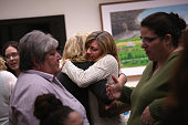 Lisa Cote Johns who's son died of a heroin overdose embraces another parent during a family addiction support group on March 23 2016 in Groton CT The...