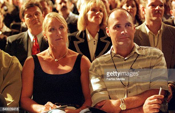 Lisa CurryKenny and Grant Kenny in the front row at the 'World Masters of Business' convention at the Brisbane Entertainment Centre 23 May 1999 AFR...