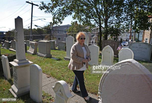 Lisa D Berenson director of development with JCAM walks among the older headstone in white marble in the Shalom Cemetery in Boston future site of the...