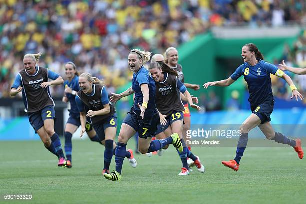 Lisa Dahlkvist of Sweden and her teammates celebrate victory in the Women's Football Semi Final between Brazil and Sweden on Day 11 of the Rio 2016...