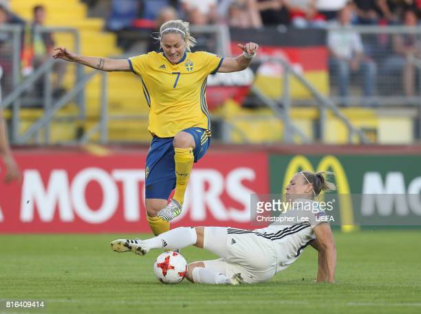 Lisa Dahlkvist of Sweden is tackled by Kristin Demann of Germany during the UEFA Women's Euro 2017 Group B match between Germany and Sweden at Rat...