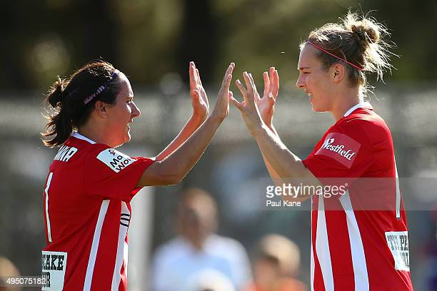 Lisa De Vanna and Marianna Tabain of City celebrate a goal during the round three WLeague match between Perth Glory and Melbourne City FC at Ashfield...