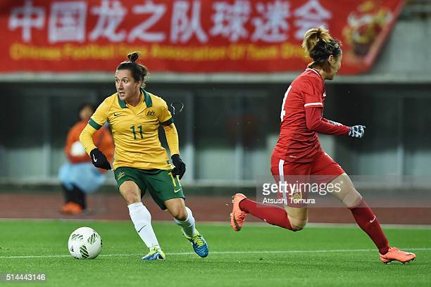 Lisa De Vanna of Australia and Zhao Rong of China compete for the ball during the AFC Women's Olympic Final Qualification Round match between...