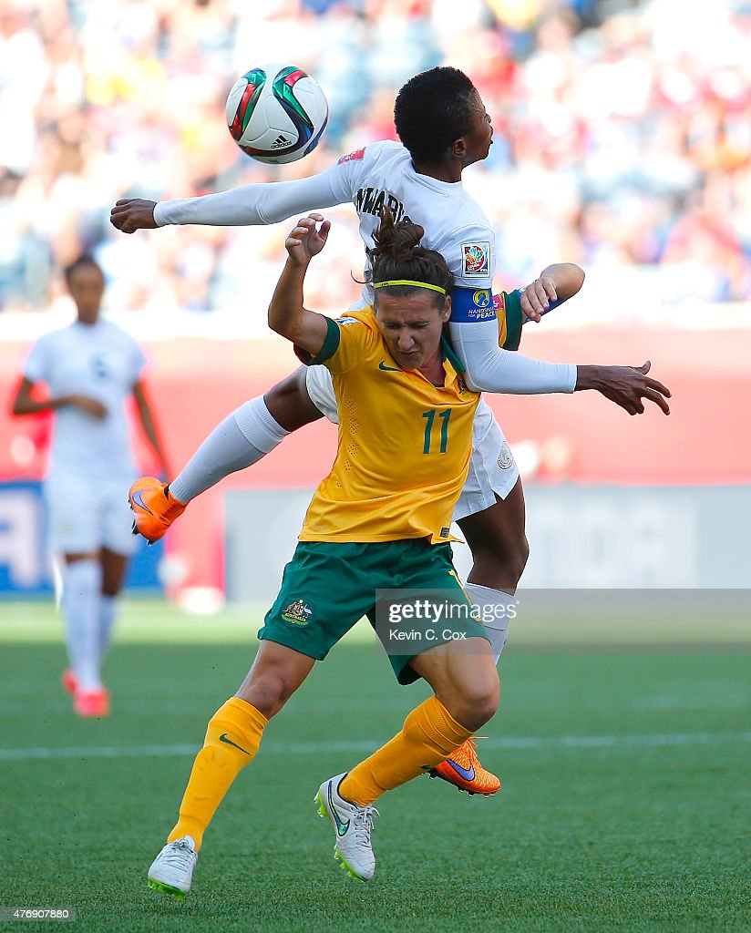 Lisa De Vanna #11 of Australia challenges Evelyn Nwabuoku #14 of Nigeria for a header during the FIFA Women's World Cup Canada 2015 match between Australia and Nigeria at Winnipeg Stadium on June 12, 2015 in Winnipeg, Canada.