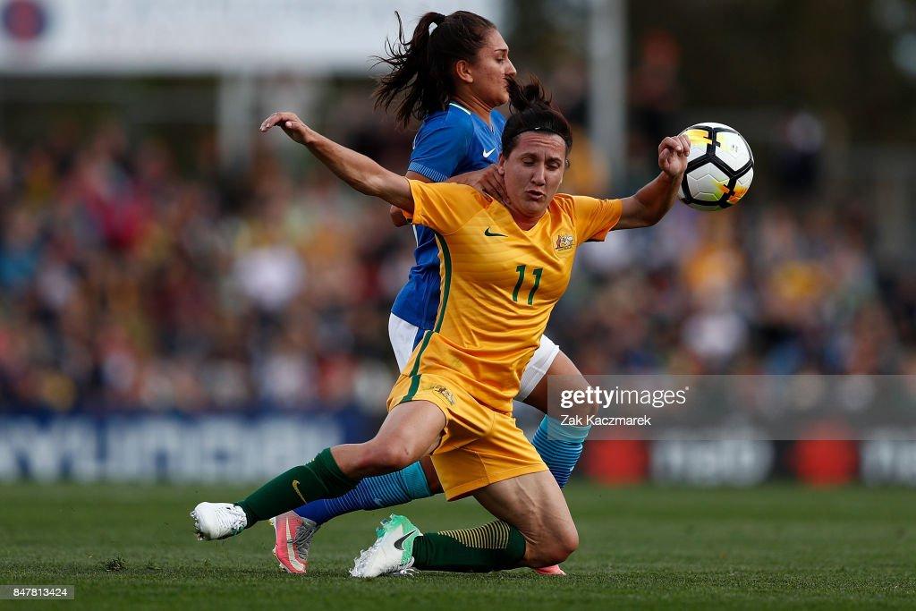 Lisa De Vanna of Australia is challenged by Leticia Santos de Oliveira of Brazil during the women's international match between the Australian Matildas and Brazil at Pepper Stadium on September 16, 2017 in Sydney, Australia.