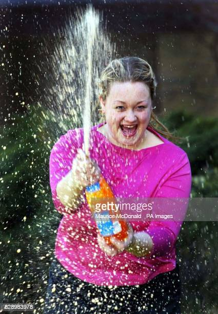 Lisa Dougan from Torphichen West Lothian celebrates with a bottle of Irn Bru during a photocall at Glasgow's Hilton Hotel The17yearold supermarket...