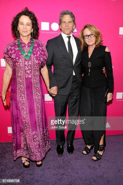 Lisa Eisner Eric Eisner and Ann Philbin at the MOCA Gala 2017 honoring Jeff Koons at The Geffen Contemporary at MOCA on April 29 2017 in Los Angeles...