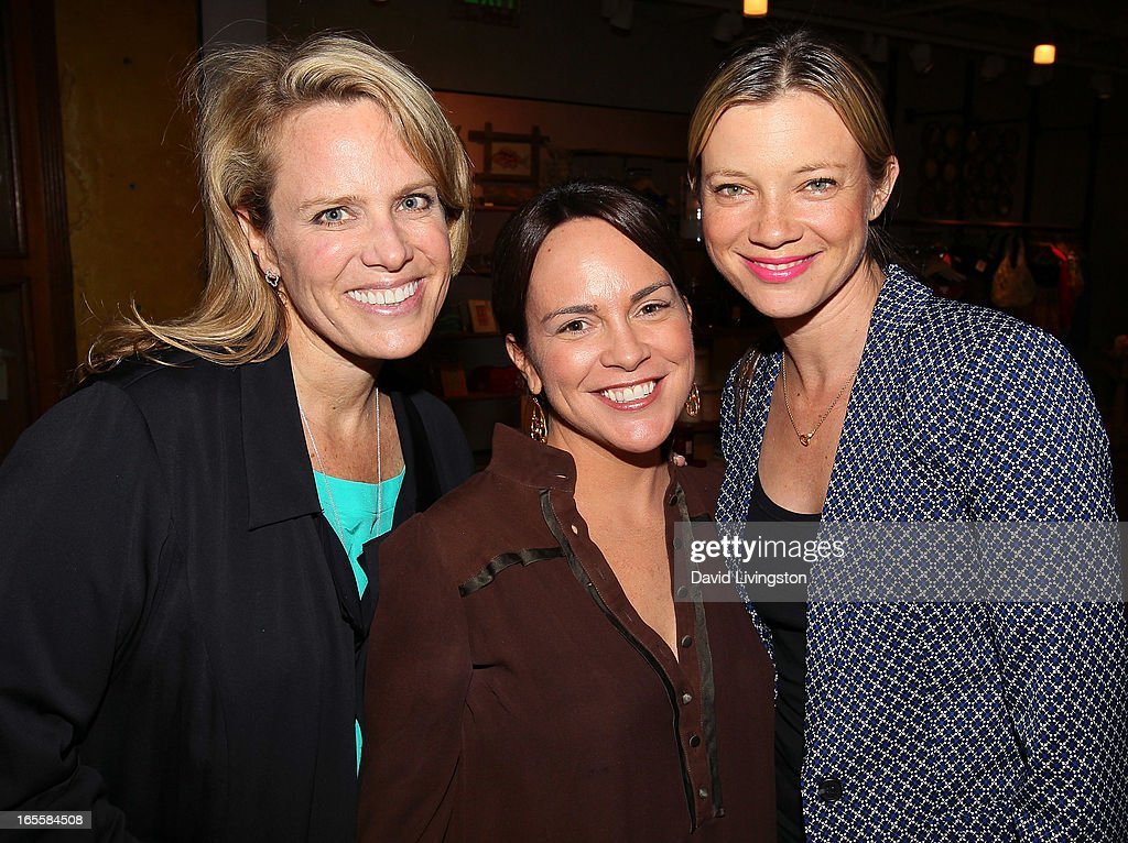 Lisa Erspamer, Kimi Culp and actress <a gi-track='captionPersonalityLinkClicked' href=/galleries/search?phrase=Amy+Smart&family=editorial&specificpeople=239532 ng-click='$event.stopPropagation()'>Amy Smart</a> attend a cocktail party and book signing for 'A Letter to My Dog: Notes to Our Best Friends' at Anthropologie on April 4, 2013 in Beverly Hills, California.