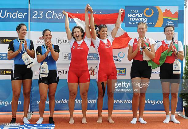 Lisa Farthofer and Magdalena Lobing of Austria celebrate winning gold in the Women's Double Sculls Final with silver medalists Aikaterini Nikolaidou...