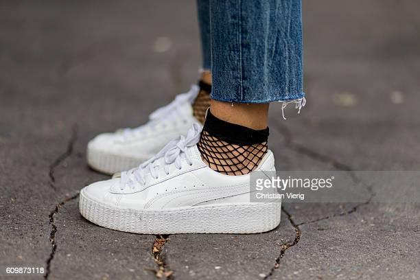 Lisa Hahnbeuck wearing Puma Fenty Creeper Sneaker Fishnet Socks Asos outside Fendi during Milan Fashion Week Spring/Summer 2017 on September 22 2016...