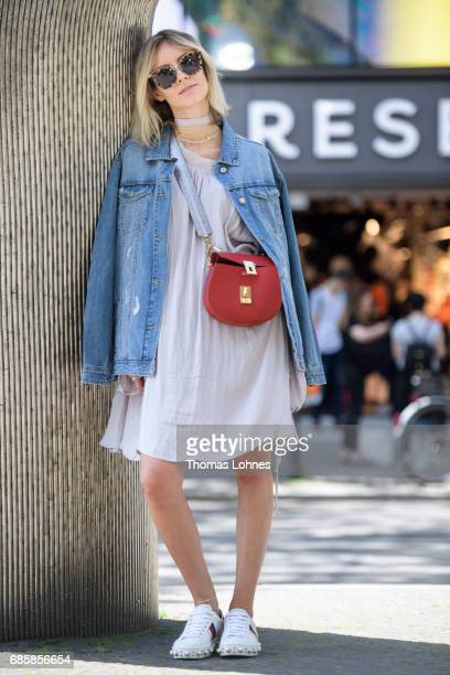 Lisa Hahnbueck dressed with an oversized frock and a jeans jacket attends the RESERVED Store Opening on May 17 2017 in Berlin Germany