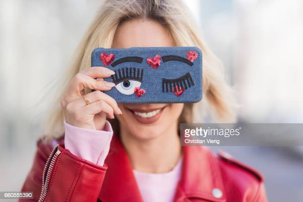 Lisa Hahnbueck smiling with her Chiara Ferragni iphone case wearing Coach ICON Moto Leather Jacket Jbrand Carola High Waist Jeans Urban Outfitters...