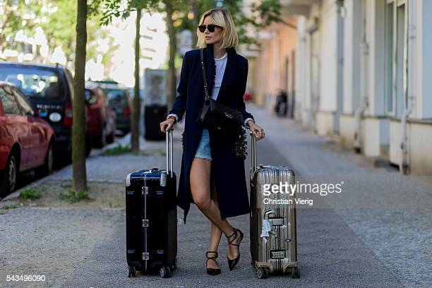 Lisa Hahnbueck travelling with Rimowa suitcase during the MercedesBenz Fashion Week Berlin Spring/Summer 2017 on June 28 2016 in Berlin Germany