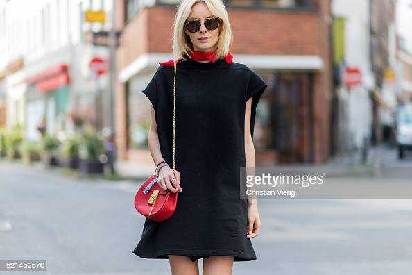 Lisa Hahnbueck wearing a black oversized hoody from Rick Owens a black dress from Maje a red Chloe bag and a red kerchief on April 14 2016 in Cologne...