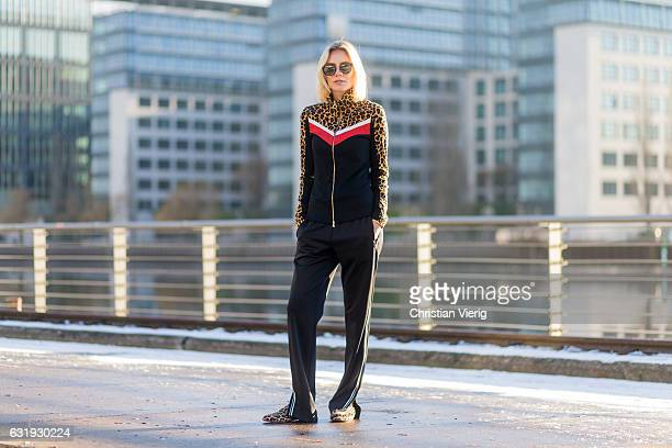 Lisa Hahnbueck wearing a black track suit with leopard print and Marc Cain loafers during the MercedesBenz Fashion Week Berlin A/W 2017 on January 17...
