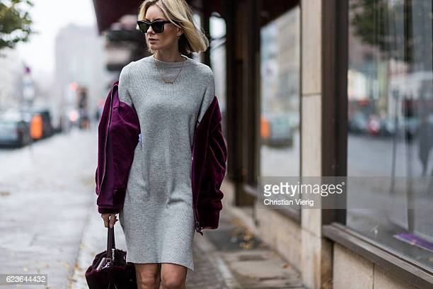 Lisa Hahnbueck wearing a bordeaux Aigner Faux Fur Bomber Jacket a grey Duffy Cashmere Knit Aeyde Patent Leather Naplak Ankle Boots Aigner Carla Bag...