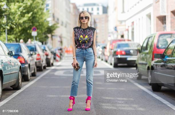 Lisa Hahnbueck wearing a sleeveless black Louis Vuitton SS 17 tshirt with print light toned cropped Levis Wedgie denim jeans pink Christian Louboutin...