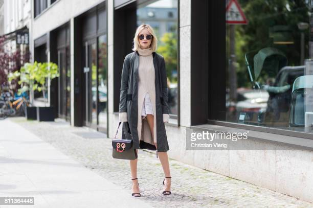 Lisa Hahnbueck wearing a Strenesse Long bomber jacket Agnona Cashmere turtle neck sweater Gina Tricot linen shorts Mai Piu Senza high heels JW...